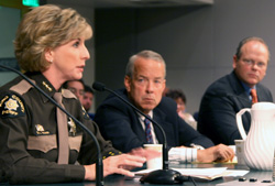 KC Sheriff Sue Rahr and KC Prosecutor Dan Satterberg [far right]